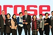 <p>Group photo of Brose management representatives receiving the award on stage. </p>