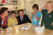<p>Bavarian Minister for Family Affairs, Christine Haderthauer (left) and Chairman of the Brose Group, Michael Stoschek (3rd f. l.) listen to children from the Kids' Club explain the experiments they recently conducted.</p>