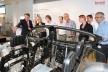 <p>Über Trends im Leichtbau informierten sich Lehrkräfte aus ganz Nordbayern bei dem Automobilzulieferer Brose. Wie Leichtbauziele bei den Produkten umgesetzt werden, erläuterte Brose Ausbildungsleiter Michael Stammberger bei einem Rundgang durch den Standort.</p>